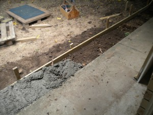 cement poured over un even ground no level base , no rebar and two eeks later its shifting