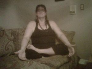 Mia sits lotus