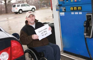 man-with-disabilities-holds-sign-that-says-dont-make-me-beg-for-gas-at-gas-station